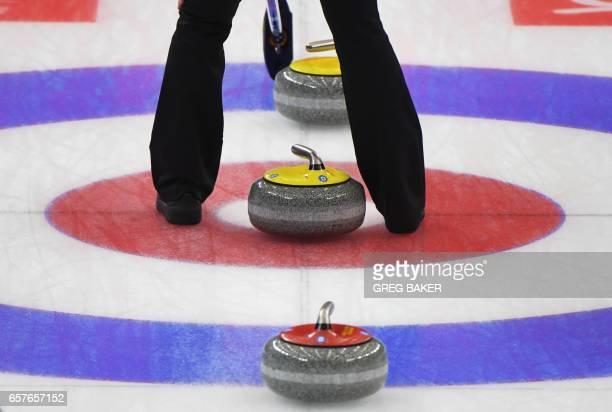 TOPSHOT Russia's Anna Sidorova stands over stones during their semifinal win against Sweden at the Women's Curling World Championships in Beijing on...