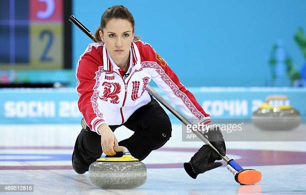 Russia's Anna Sidorova throws the stone during the Women's Curling Round Robin Session 9 between Russia and Canada at the Ice Cube Curling Center in...