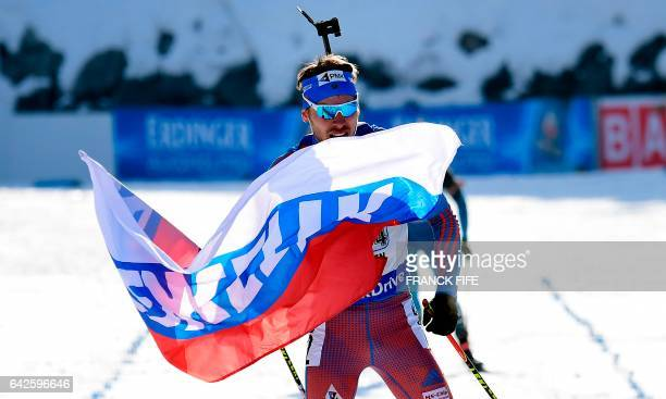 Russia's Anton Shipulin celebrates in the finish area with a Russian flag of the 2017 IBU World Championships Biathlon Men's 4 x 75km relay...