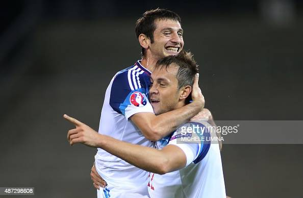 Russias Artem Dzyuba celebrate with his teammate Alan Dzagoev after scoring during the Euro 2016 qualifying football match between Liechtenstein and...