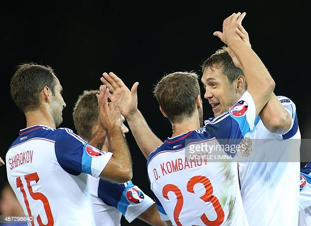 Russias Artem Dzyuba celebrate with his teammates Dmitri Kombarov and Roman Shirokov after scoring during the Euro 2016 qualifying football match...