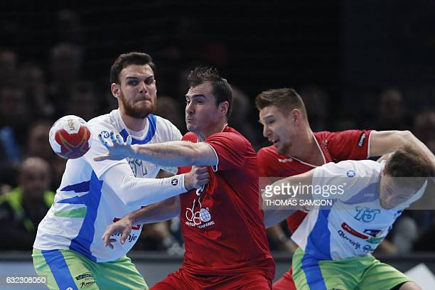 Russia's back Sergei Shelmenko passes the ball under the pressure of Russia's centre back Alexander Shkurinskiy during the 25th IHF Men's World...