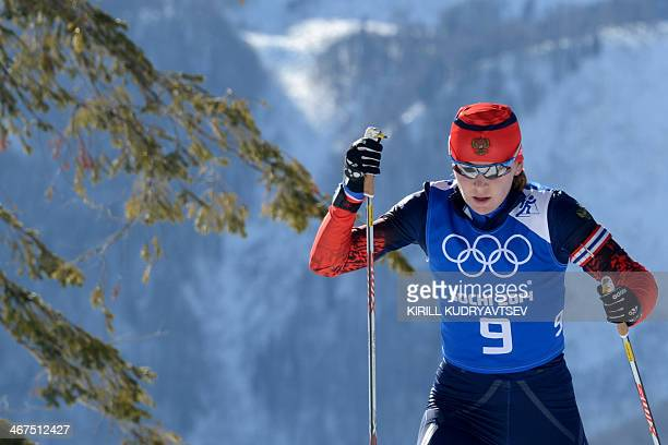 Russia's biathlete Ekaterina Glazyrina skis during a biathlon training session at the Laura Centre in Rosa Khutor near Sochi on February 7 2014 few...