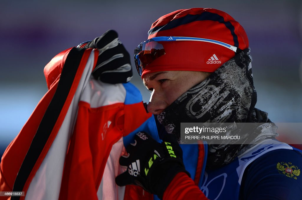 Russia's biathlon athlete Olga Zayceva adjusts her clothes during a training session at the Laura Cross Country Skiing and Biathlon Centre in Rosa Khutor, near Sochi, on February 5, 2014. The Sochi Olympic Winter Games 2014 will run from February 7 to 23.