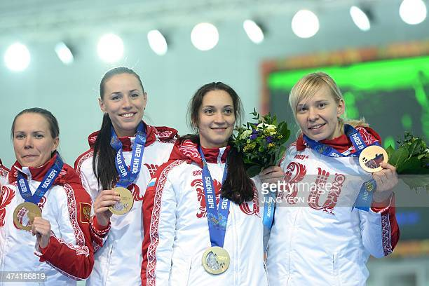 Russia's bronze medalists Olga Graf Ekaterina Lobysheva Ekaterina Shikhova and Yuliya Skokova pose during the Women's Speed Skating Team Pursuit...