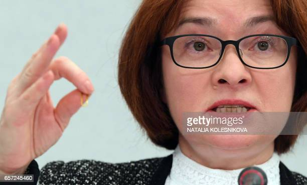 Russia's Central Bank chief Elvira Nabiullina gives a press conference in Moscow on March 24 2017 Russia's central bank cut its key rate on March 24...