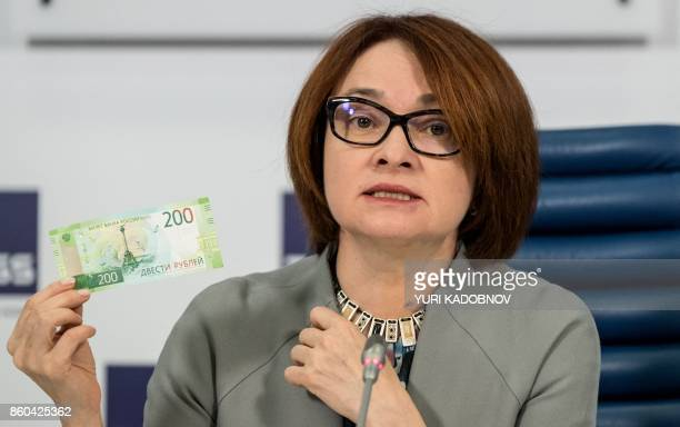 Russia's Central bank chief Elvira Nabiullina presents the new 200 ruble banknote bearing the image of Sevastopol's Monument to the Scuttled Ships...