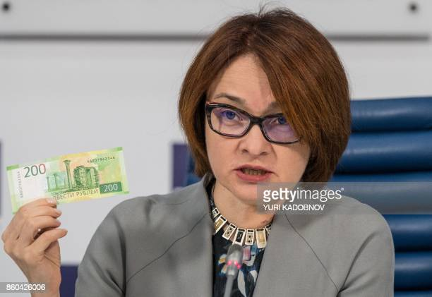 Russia's Central bank chief Elvira Nabiullina presents the new 200 ruble banknote bearing the image of Chersonesus Tavrichesky Moscow October 12 2017...