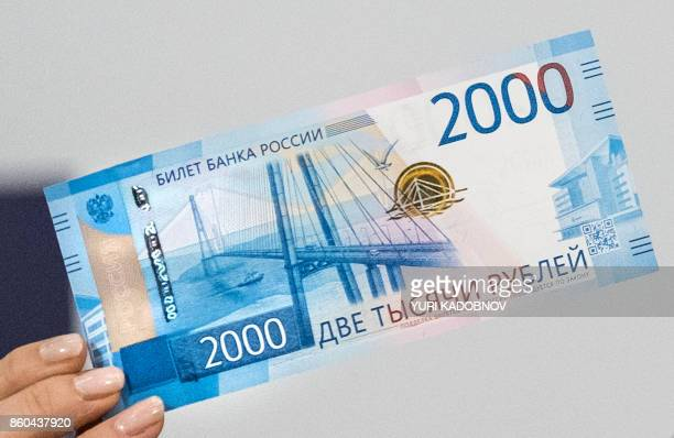 Russia's Central bank chief Elvira Nabiullina presents the new 2000 ruble banknote bearing the image of Vladivostok's bridge over the Golden Horn bay...