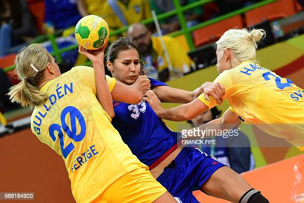 TOPSHOT Russia's centre back Ekaterina Ilina vies with Sweden's centre back Isabelle Gullden L0 and Sweden's right wing Nathalile Hagman during the...