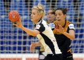 Russia's centreback Tatiana Khmyrova is pushed by Spain's Begona Fernandez during the 2012 EHF European Women's Handball Championship Group II match...