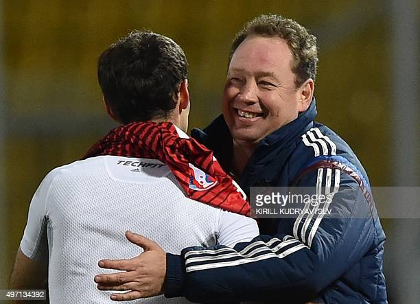 Russia's coach Leonid Slutski and Russia's midfielder Roman Shirokov celebrate their victory over Portugal after the friendly football match between...