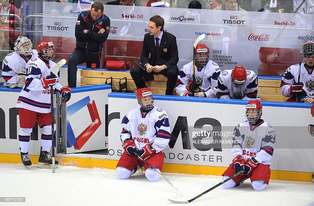 Russia's coaches and players react after being defeated 2-1 by Finland in a bronze medal match of the IIHF U18 International Ice Hockey World Championship in Sochi on April 28, 2013.