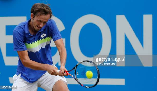 Russia's Daniil Medvedev returns against Bulgaria's Grigor Dimitrov during their men's singles quarterfinal tennis match at the ATP Aegon...