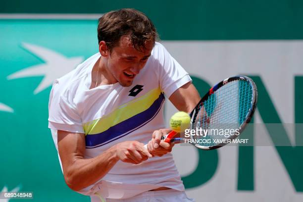 Russia's Daniil Medvedev returns the ball to France's Benjamin Bonzi during their qualification round match at the Roland Garros 2017 French Tennis...