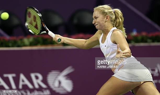 Russia's Daria Gavrilova returns the ball to Serena Williams of the US during their match on the second day of the WTA Qatar Open in the capital Doha...