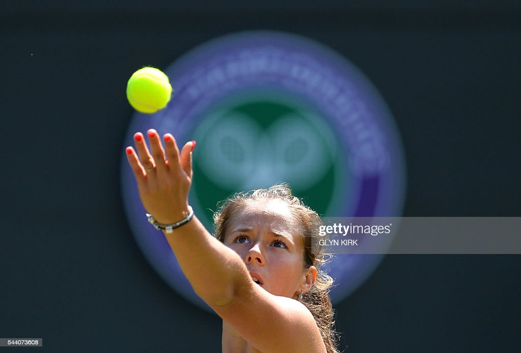 Russia's Daria Kasatkina serves to US player Venus Williams during their women's singles third round match on the fifth day of the 2016 Wimbledon Championships at The All England Lawn Tennis Club in Wimbledon, southwest London, on July 1, 2016. / AFP / GLYN