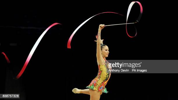 Russia's Daria Kondakova goes on to finish in first place as she performs with the Ribbon during the Visa International Gymnastics at the North...