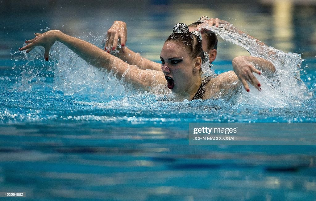 Russia's Daria Korobova and <a gi-track='captionPersonalityLinkClicked' href=/galleries/search?phrase=Svetlana+Kolesnichenko&family=editorial&specificpeople=7986692 ng-click='$event.stopPropagation()'>Svetlana Kolesnichenko</a> perform their duet free routine in the synchronised swimming event of the 32nd LEN European Swimming Championships on August 14, 2014 in Berlin.