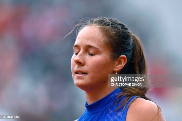 Russia's Darya Kasatkina reacts during her tennis match against Romania's Simona Halep during their tennis match at the Roland Garros 2017 French...