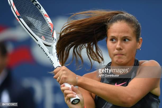 Russia's Darya Kasatkina returns the ball to Latvia's Jelena Ostapenko during their Qualifying Women's Singles match at the 2017 US Open Tennis...