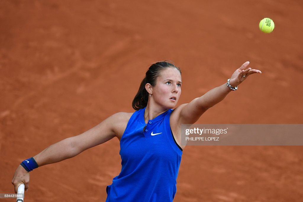 Russia's Darya Kasatkina serves the ball to France's Virginie Razzano during their women's second round match at the Roland Garros 2016 French Tennis Open in Paris on May 26, 2016. / AFP / PHILIPPE