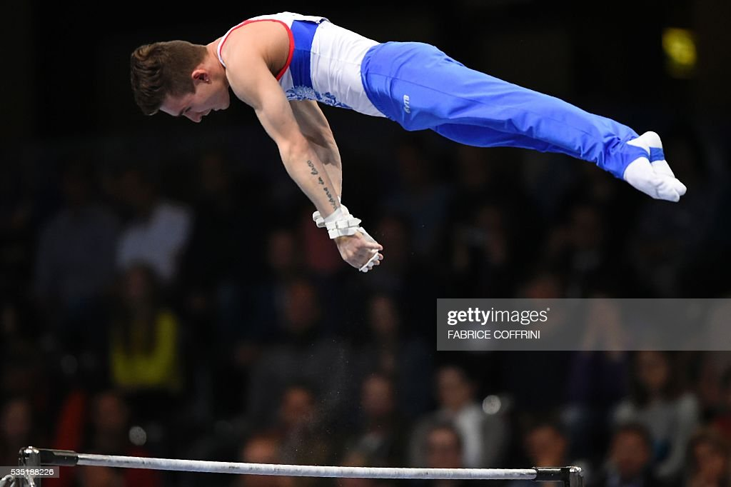 Russias David Belyavskiy performs during the Mens Horizontal Bar competition of the European Artistic Gymnastics Championships 2016 in Bern, Switzerland on May 29, 2016. / AFP / FABRICE