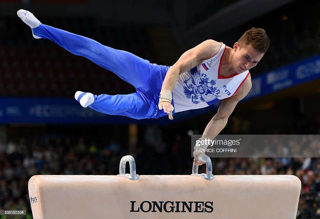 Russias David Belyavskiy performs during the Mens Pommel Horse competition of the European Artistic Gymnastics Championships 2016 in Bern, Switzerland on May 29, 2016. / AFP / FABRICE