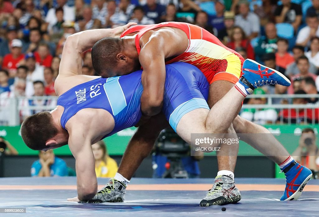 TOPSHOT Russia's Davit Chakvetadze wrestles with Ukraine's Zhan Beleniuk in their men's 85kg grecoroman final match on August 15 during the wrestling...
