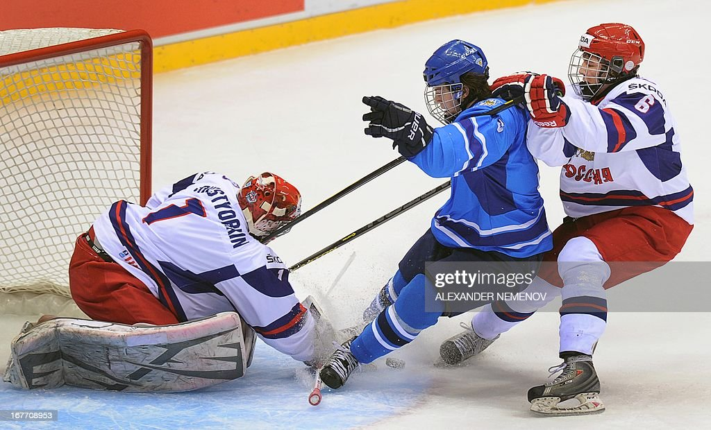 Russia's defender Nikolai Demidov (R) stops Finland's forward Jonatan Tanus (C) attacking Russia's goalie Igor Shestyorkin (L) during a bronze medal game of the IIHF U18 International Ice Hockey World Championship in Sochi on April 28, 2013.