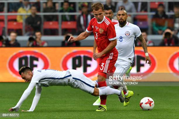 Russia's defender Roman Shishkin and Chile's forward Martin Rodriguez vie for the ball during a friendly football match between Russia and Chile at...