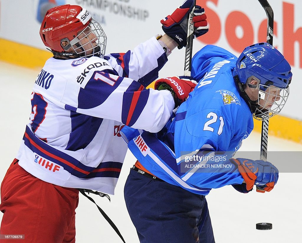 Russia's defender Vladislav Lysenko (L) attacks Finland's forward Otto Rauhala during a bronze medal game of the IIHF U18 International Ice Hockey World Championship in Sochi on April 28, 2013.