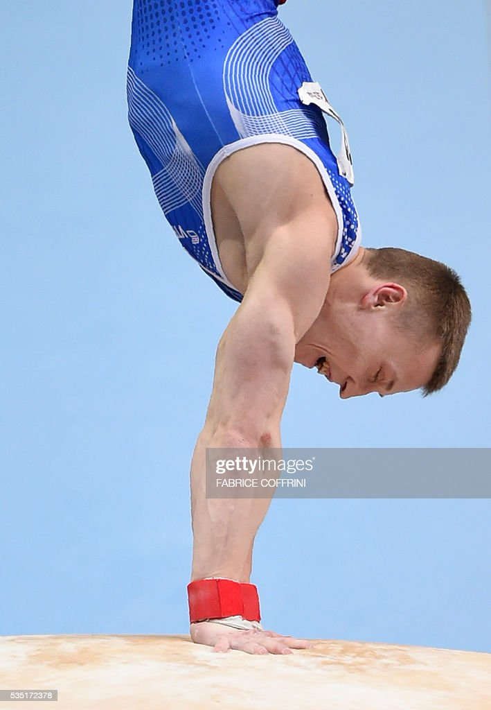 Russias Denis Abliazin performs during the Mens Vault competition of the European Artistic Gymnastics Championships 2016 in Bern, Switzerland on May 29, 2016. / AFP / FABRICE
