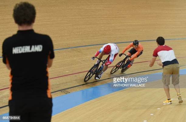 Russia's Denis Dmitriev and Netherlands Harrie Lavreysen compete in the men's sprint final at the Hong Kong Velodrome during the Track Cycling World...