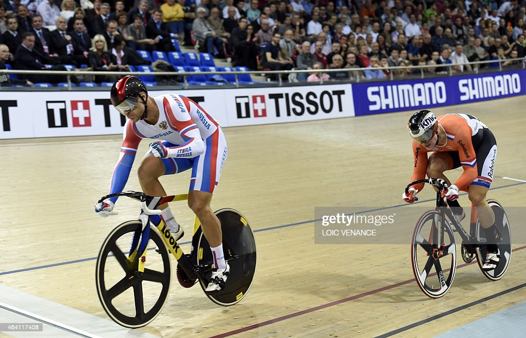 Russia's <a gi-track='captionPersonalityLinkClicked' href=/galleries/search?phrase=Denis+Dmitriev&family=editorial&specificpeople=5492378 ng-click='$event.stopPropagation()'>Denis Dmitriev</a> (L) reacts after finishing ahead of the Netherlands' Jeffrey Hoogland in the Men's Sprint Semifinals decider race at the UCI Track Cycling World Championships in Saint-Quentin-en-Yvelines, near Paris, on February 22, 2015.