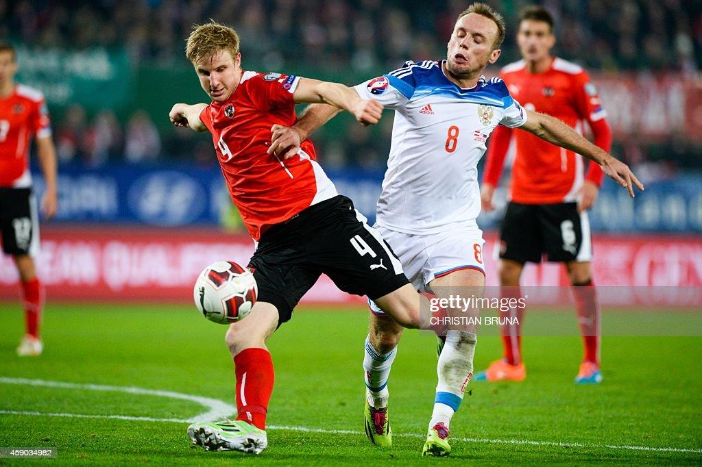 Russia's Denis Glushakov and Austria's Martin Hinteregger vie during the UEFA 2016 European Championship qualifying round Group G football match...
