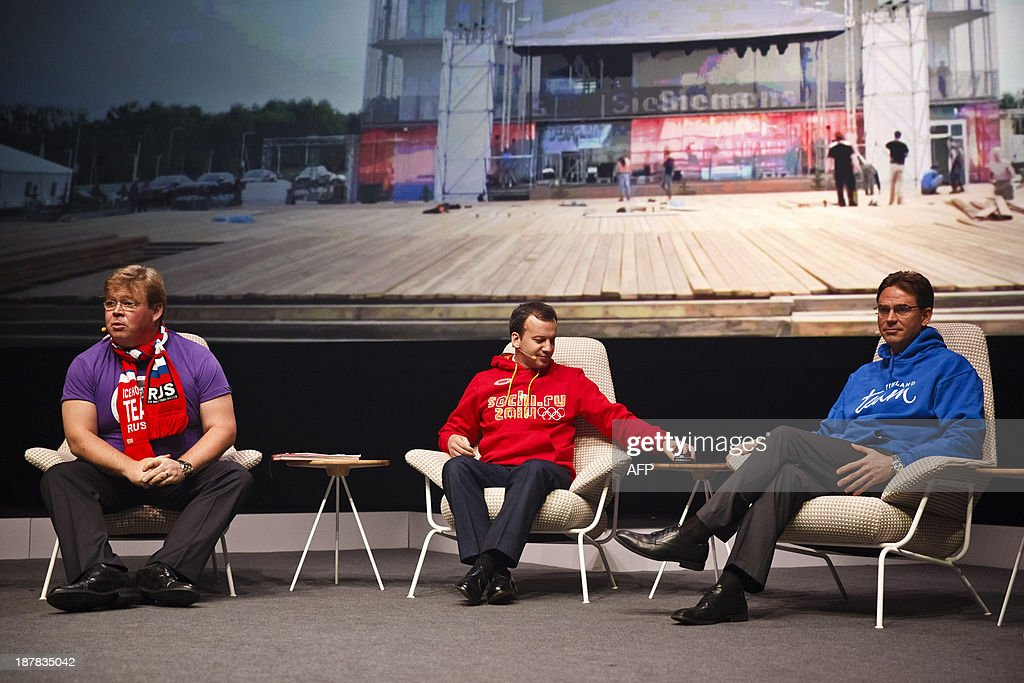 Russia's Deputy Prime Minister Arkady Dvorkovich (C) wears a sweet-shirt with the logo of the 2014 Olympic Winter Games in Stochi as he chats with Premier Minister of Finland Jyrki Katainen (R) and advisor to the President of Solkovo Pekka Viljakainen (L) at the Slush startup conference in Helsinki, on November 13, 2013. Slush is a conference bringing together the early-stage startup scene in Northern Europe and Russia along with top-tier angel investors and venture capitalists from Europe and the US. PHOTO / LEHTIKUVA / Roni Rekomaa