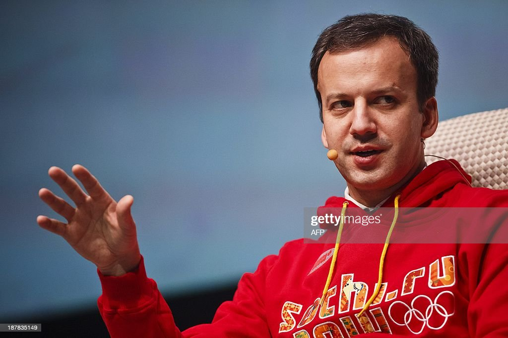 Russia's Deputy Prime Minister Arkady Dvorkovich wears a sweet-shirt with the logo of the 2014 Olympic Winter Games in Sochi as he speaks at the Slush startup conference in Helsinki, on November 13, 2013. Slush is a conference bringing together the early-stage startup scene in Northern Europe and Russia along with top-tier angel investors and venture capitalists from Europe and the US. PHOTO / LEHTIKUVA / Roni Rekomaa