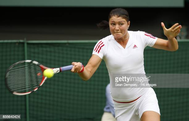 Russia's Dinara Safina in action against France's Amelie Mauresmo during the Wimbledon Championships 2009 at the All England Tennis Club