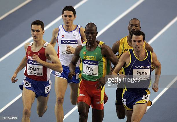 Russia's Dmitriy Bogdanov wins his 800m heat ahead of Brazil's Fabiano Peanha and Senegal's Abdoulaye Wagne on March 7 2008 during the IAAF World...