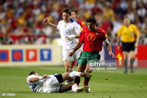 Russia's Dmitry Loskov and Portugal's Luis Figo