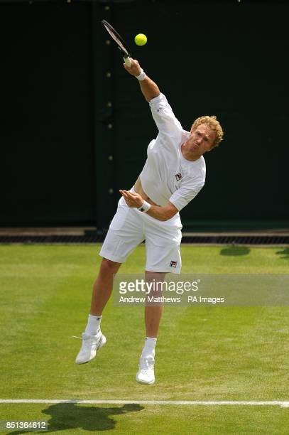 Russia's Dmitry Tursunov in action against Germany's Tommy Haas