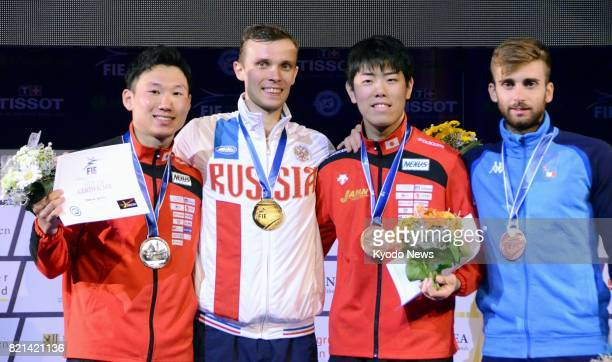 Russia's Dmitry Zherebchenko poses for a photo after winning the men's individual foil at the World Fencing Championships in Leipzig Germany on July...
