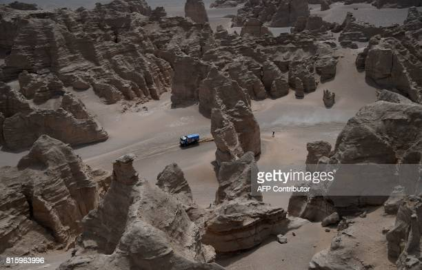 Russia's driver Anton Shibalov codriver Andrey Mokeev and Dmitrii Nikitin compete during the Stage 9 of the Silk Way 2017 between Urumqi and Hami...