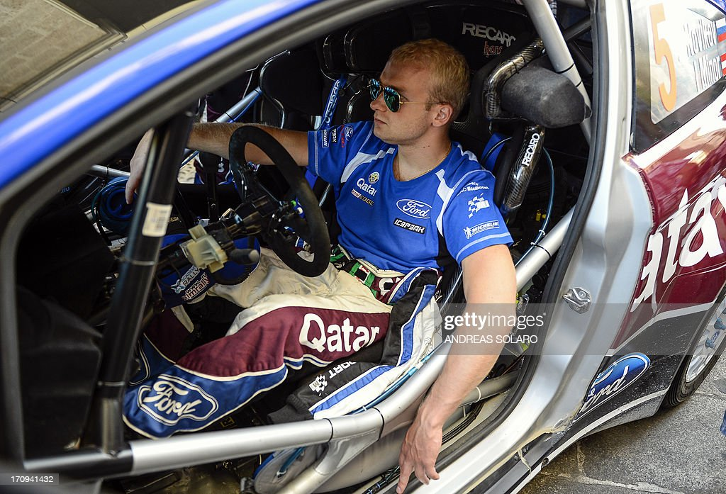 Russia's driver Evgeny Novikov waits in his car, a Ford Fiesta RS WRC, during the opening ceremony of the FIA World Rally Championship of Italy in Sassari, on the Italian island of Sardinia on June 20, 2013.