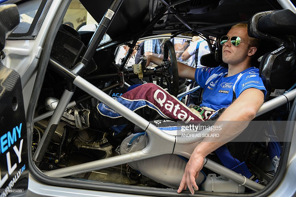 Russia's driver Evgeny Novikov waits in his car, a Ford Fiesta RS WRC, during the opening ceremony of the FIA World Rally Championship of Italy in Sassari, on the Italian island of Sardinia on June 20, 2013. AFP PHOTO / ANDREAS SOLARO