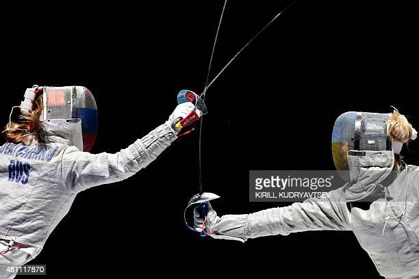 Russia's Ekaterina Dyachenko vies Ukraine's Olga Kharlan compete during the women's sabre team gold match at the 2015 World Fencing Championships in...
