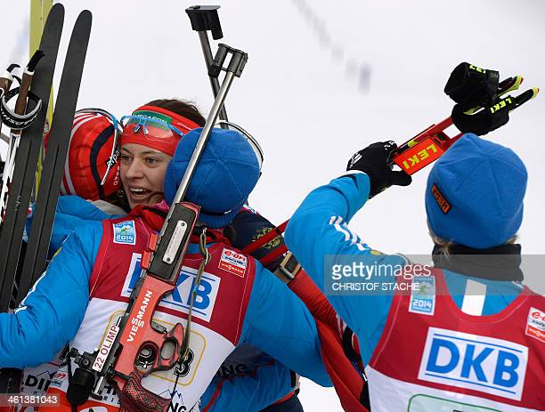 Russia's Ekaterina Glazyrina Olga Vilukhina Irina Starykh and Olga Zaitseva celebrate after the women's 4x6 km relay at the Biathlon World Cup on...