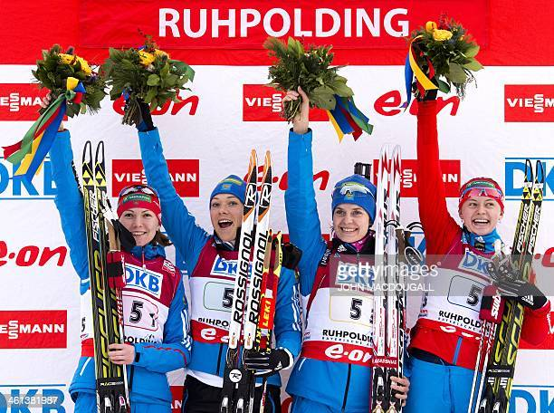 Russia's Ekaterina Glazyrina Olga Zaitseva Irina Starykh and Olga Vilukhina celebrate on the podium after taking the first place in the Women's 4x6...
