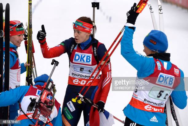Russia's Ekaterina Glazyrina Olga Zaitseva Olga Vilukhina and Irina Starykh react after the women's 4x6 km relay at the Biathlon World Cup on January...